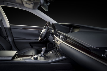 Luxury car inside. Interior of prestige modern car. Comfortable leather seats. Black perforated leather seats. Isolated with clipping path.