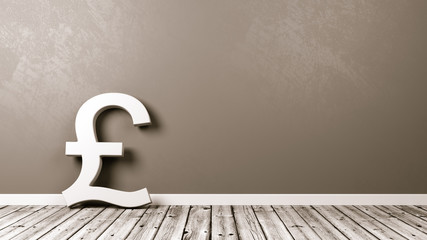 Pound British Currency Sign on Wooden Floor Against Wall