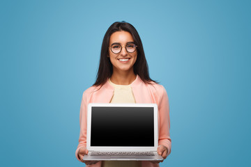 Happy business woman holding laptop