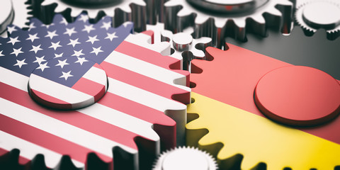 Germany and US of America flags on metal cogwheels. 3d illustration