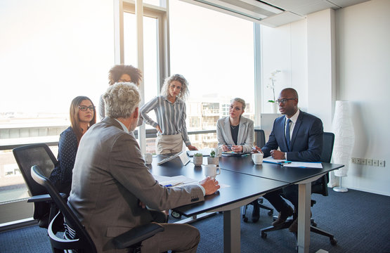 Executives talking business together in an office boardroom