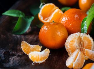 Fotoväggar - Tangerines. Fresh organic ripe mandarines closeup on wooden table. Top view