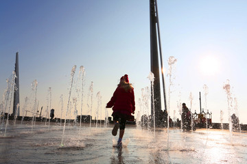 little girl running through street fountains in southend on sea in essex