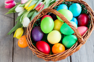 Colorful easter eggs and tulips