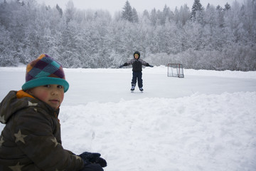 Children playing outdoors on the snow