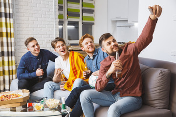 Men watching sport on tv together at home selfie pictures