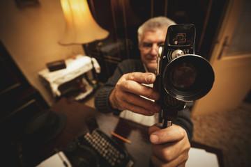 Senior Man Holding Video Camera