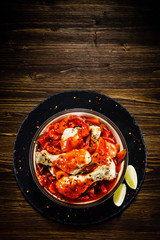 Boiled chicken drumsticks with tomato sauce