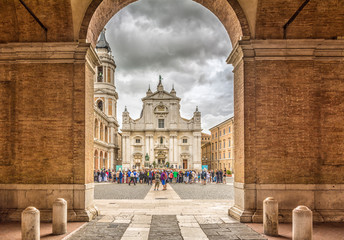 Sanctuary of the Holy House of Loreto, Marches, Italy, the Basilica facade with the Sisto V monument in the foreground