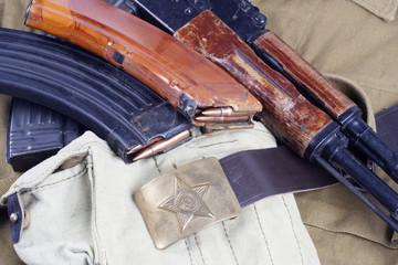 AK47 on USSR Soviet Army khaki uniform background