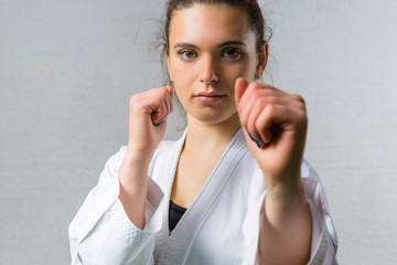 Young Woman Practicing Karate Martial Art