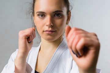 Young Woman Practicing Karate Martial Art