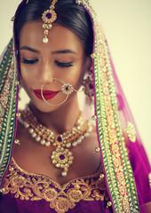Portrait of beautiful indian girl. Young hindu woman model with kundan jewelry set. Traditional India costume lehenga choli or sari