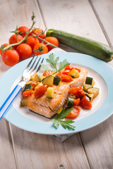 salmon with fresh tomatoes and zucchinis, selective focus