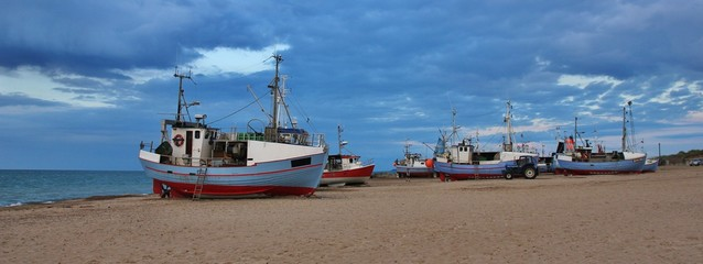 Fishing boats at Thorup Strand, Jylland. Cloudy summer evening in Denmark.