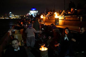 People enjoy a winter night in Istanbul