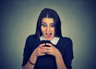Shocked woman watching cellphone