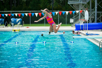 Little Girl Swim Lessons off Diving Board