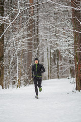 Photo of young athlete on run in winter