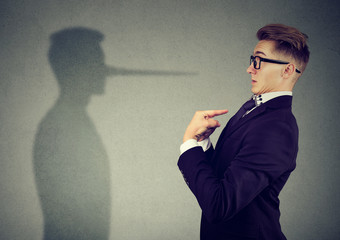 Man pointing at himself while lying