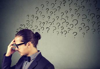 Man having plenty of questions