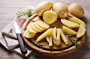 Raw potatoes and rosemary