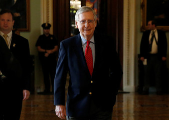 Senate Majority Leader Mitch McConnell (R-KY) walks from the Senate floor after President Donald Trump and the U.S. Congress failed to reach a deal on funding for federal agencies in Washington