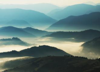 silhouettes of mountains. autumn morning in the Carpathian mountains. foggy dawn