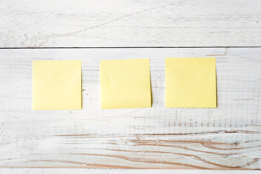 Three Blank Yellow Post It Notes Ready for any Message
