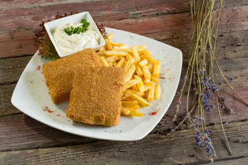 breaded cheese. On a wooden background. Top view. rustic food