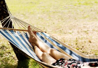 Woman relaxing in the hammock
