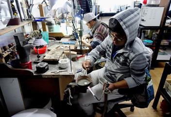 "A jewel artisan works at the ""Villa Imperial de Potosi"" jeweller's workshop in La Paz, Bolivia"