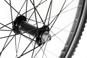 Detail of front bicycle wheel, hub and spokes of mountain bike