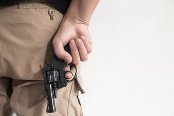 Hand shooting gun on white background.killer concept.