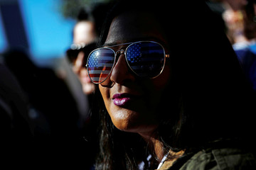 An attendee wears American flag sunglasses while participating in the second annual Women's March in Los Angeles, California