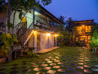 Vintage resort with check pattern of green yard in raining day at twilight