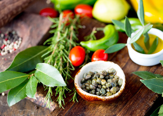 Capers and herbs. Selective focus