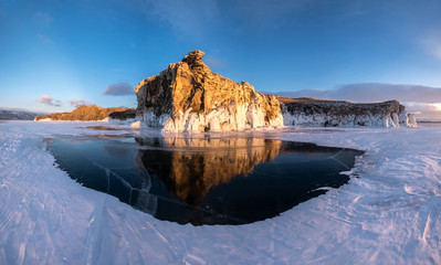 Reflection of the rock in the ice of Lake Baikal