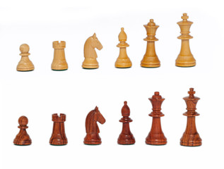 Wooden chess pieces. Chess, an ancient social game demanding to think.