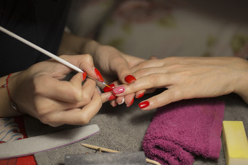 The girl's fingers. Maiden hands. Manicure on nails.