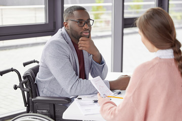 Male invalid involved in business activity, listens to female secretary who present annual report and new startup, suggests ways of canceling credit, believe in earning capacity and success.