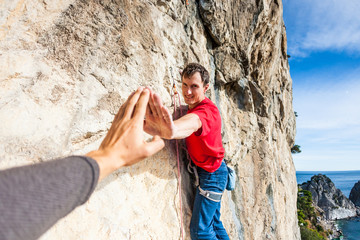 The climber gives five.