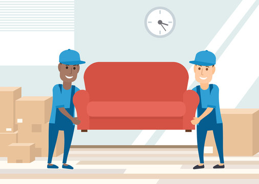 two movers carrying sofa. moving day concept