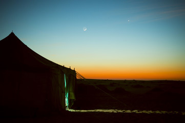 Night view of a tent at Rub Al Khali