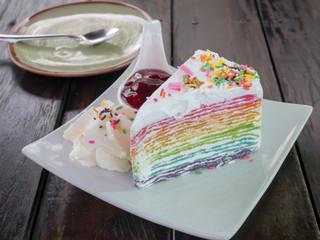 layer rainbow cake on wood table