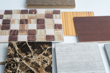 samples of material, wood , color ,ceramic , on wooden table on white background .Interior design select material for idea.