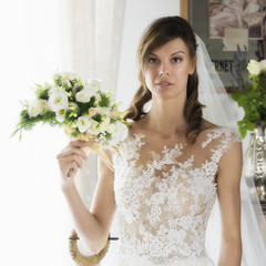 Wedding, beautiful  young bride with bouquet