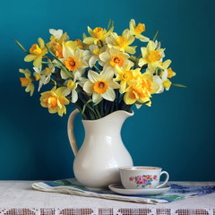 Bouquet of daffodils in a white jug. Flowers in a vase.