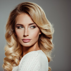 Photo of a beautiful young blond woman with curly hair