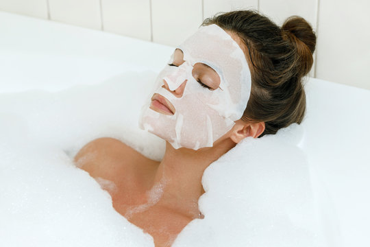 Woman with sheet mask on her face